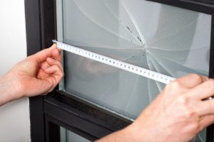 Measuring dimension of broken window before a repairing